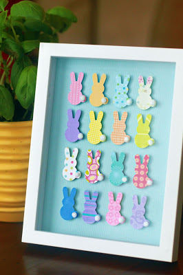 Framed collage of colourful bunnies crafted at home