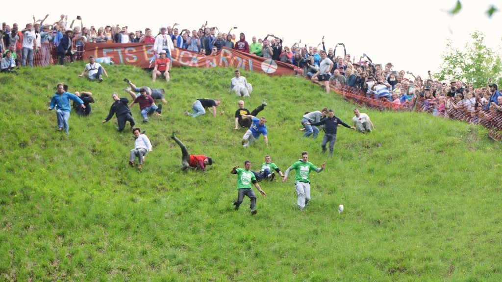 Photograph of participants in Cheese Rolling event on Cooper's Hill in Gloucestershire