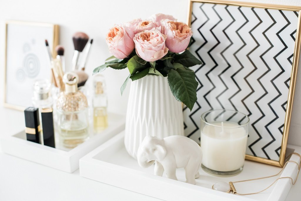 Picture of flowers on tray with make up and candles