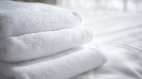 Pure white clean towels and bed linen